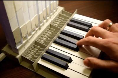 қағаздан жасалған музыкалық аспап